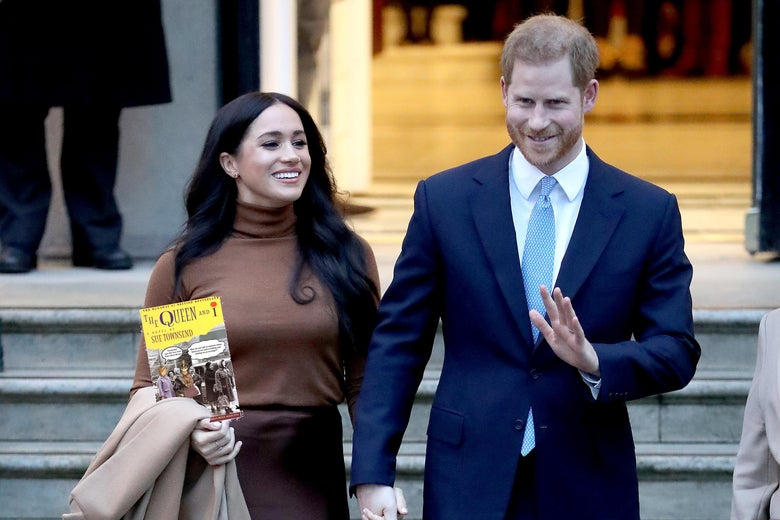 "Harry and Meghan hold a copy of ""The Queen and I."""