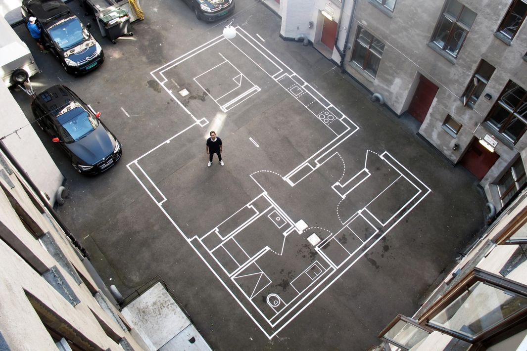 Vardehaugen architecture studio visualizes future projects with life-sized chalk drawings in the office parking lot.