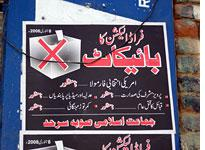 A Jamaat-i-Islami poster counsels supporters to boycott the elections          Click image to expand.