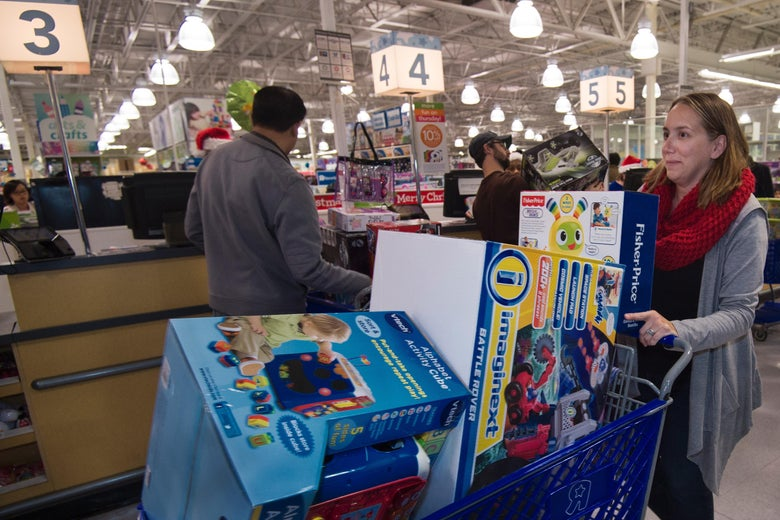 A woman pushes her cart full of toys at  a Toys-R-Us store, in Fairfax, Virginia  November 26, 2015, on a Black Friday sale that extended a day earlier into Thanksgiving evening. The  US holiday shopping season kicks off with 'Black Friday' -- the day after the Thanksgiving holiday -- with a frenzy expected at stores around the country as retailers slash prices.         AFP PHOTO/PAUL J. RICHARDS / AFP / PAUL J. RICHARDS        (Photo credit should read PAUL J. RICHARDS/AFP/Getty Images)