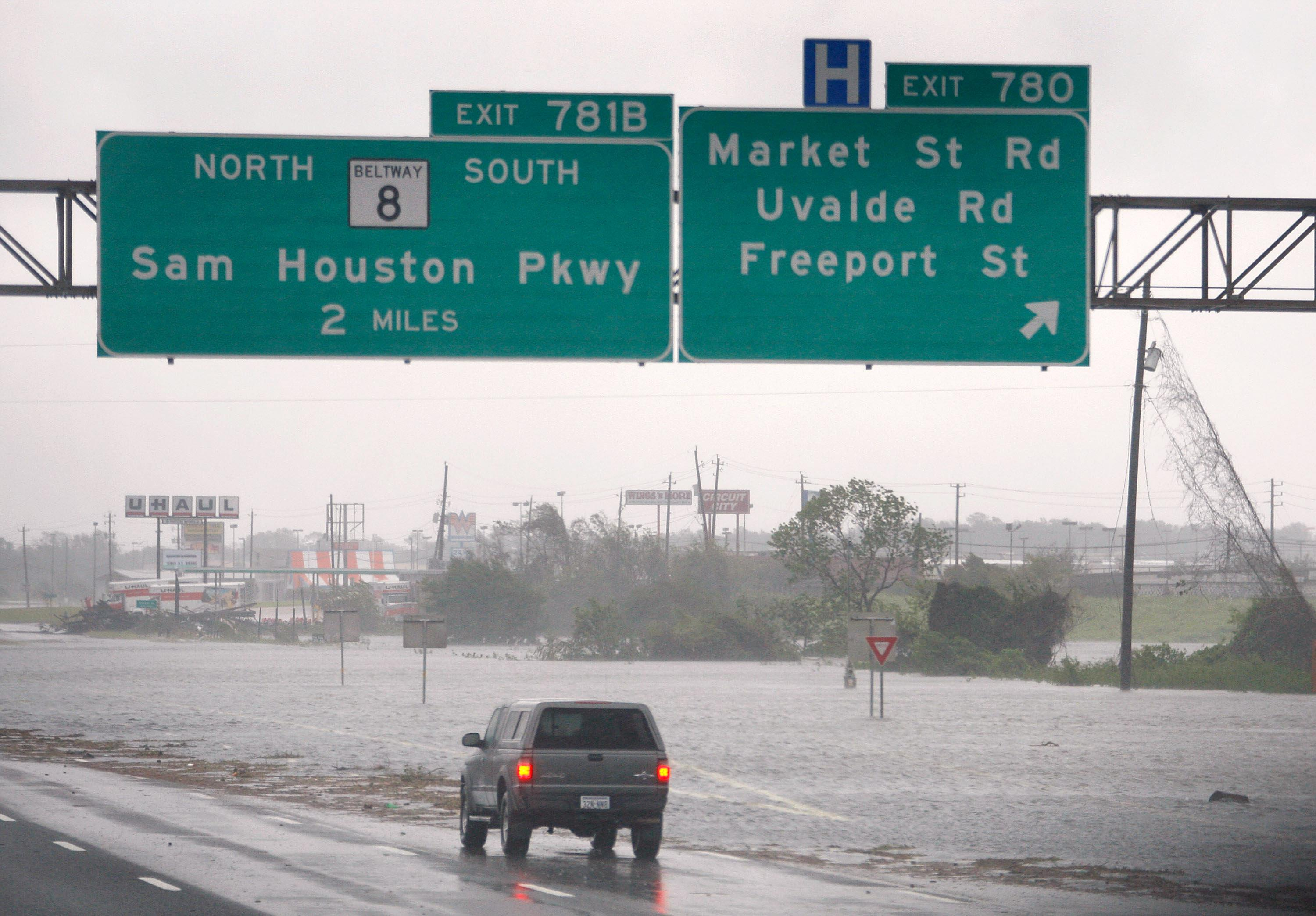 A driver surveys a stretch of Interstate 10 flooded by Hurricane Ike, Sept. 13, 2008, near Houston.