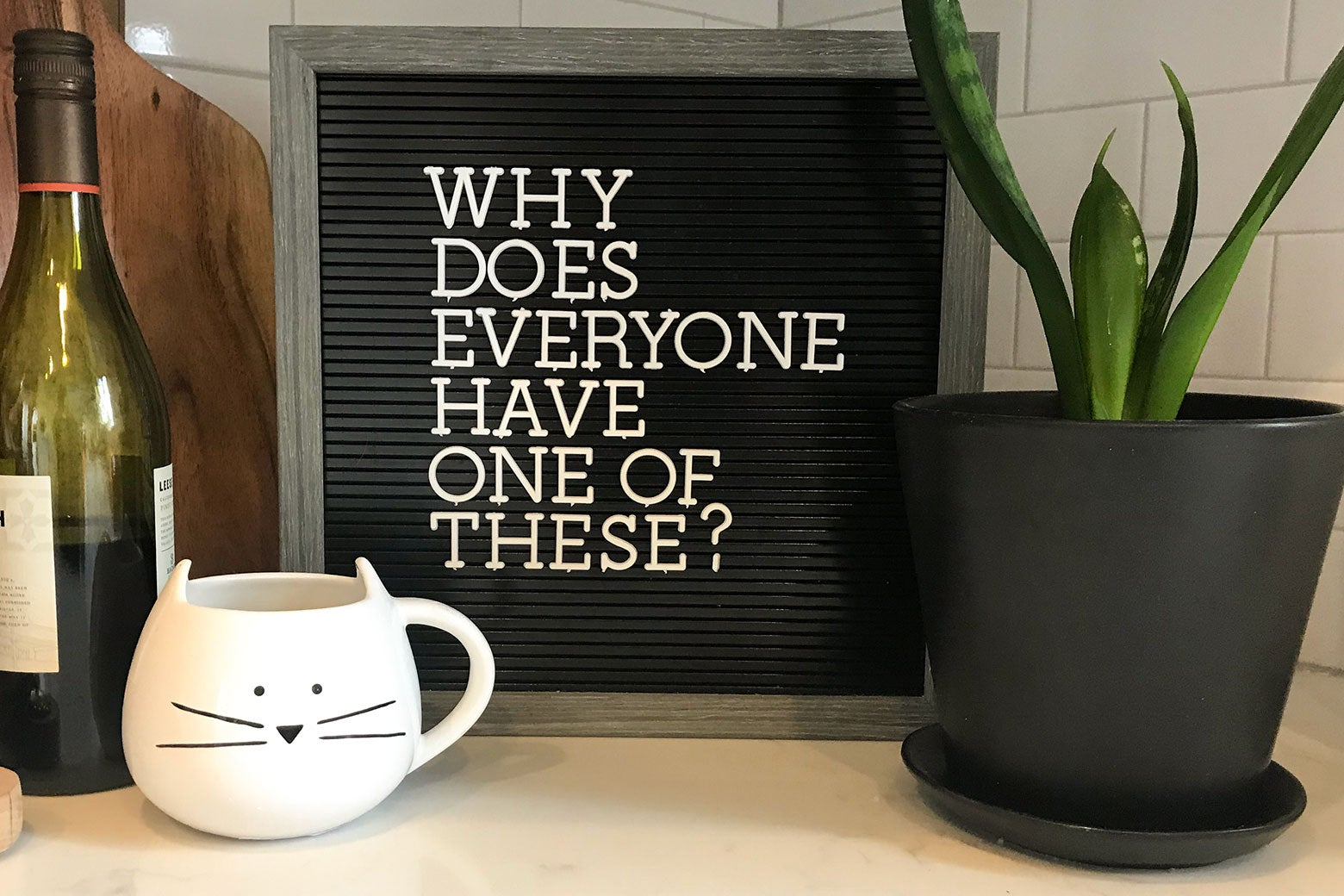 A letterboard with an important question