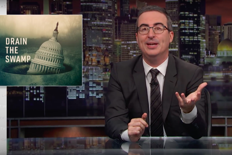 "Last Week Tonight's John Oliver in front of a graphic reading ""Drain the Swamp."""