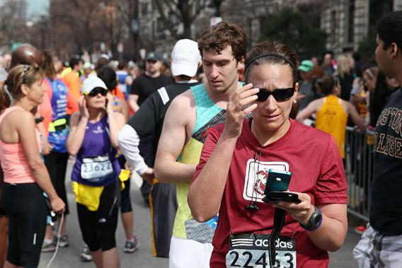 Runners react near Kenmore Square after two bombs exploded during the 117th Boston Marathon.