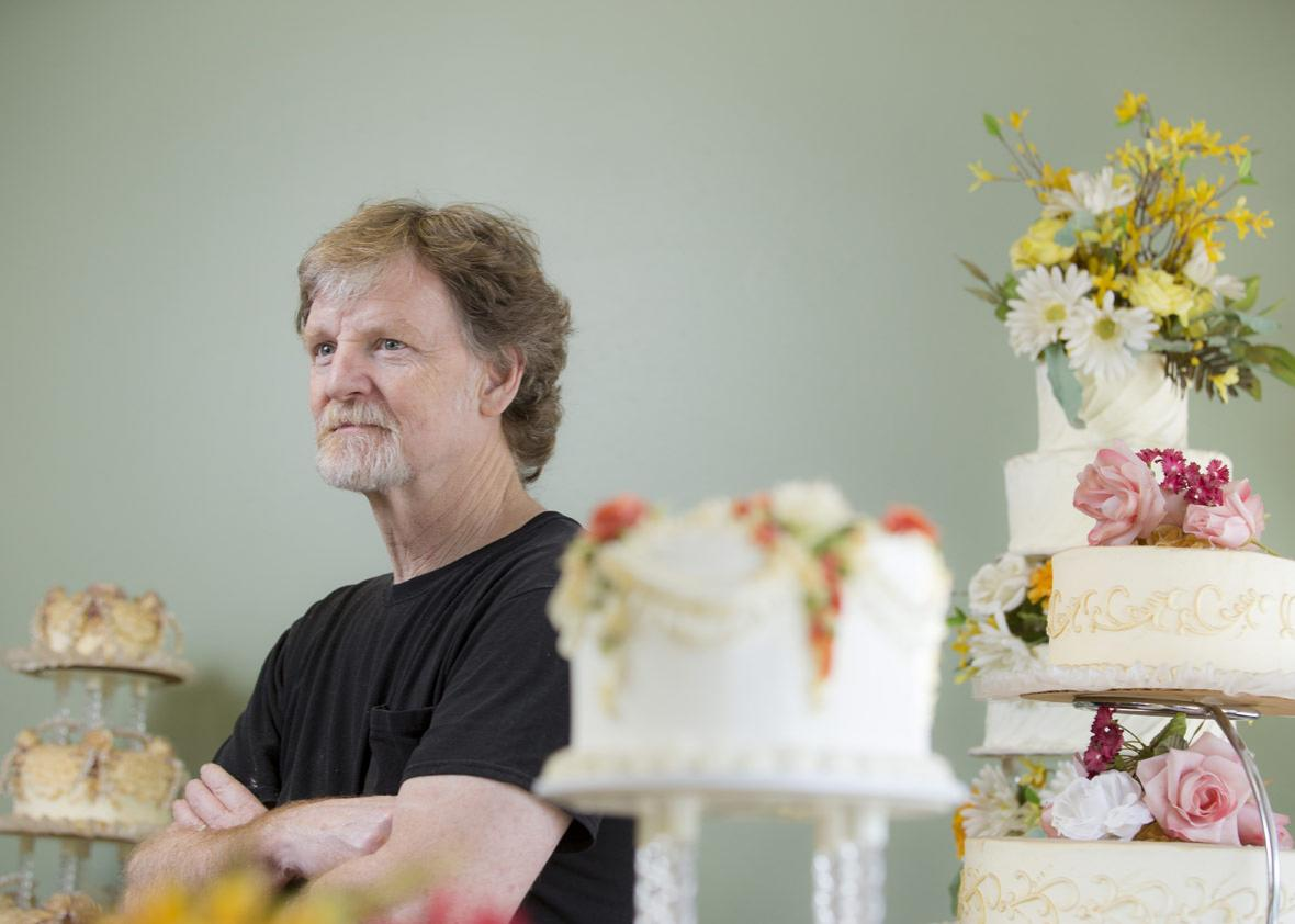 Jack Phillips stands for a portrait near a display of wedding cakes in his Masterpiece Cakeshop