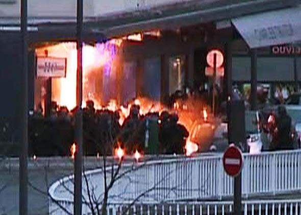 French police special forces launching an assault at a kosher grocery store.