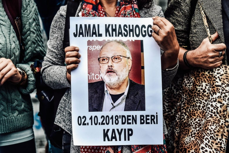"A woman holds a portrait of missing journalist Jamal Khashoggi reading ""Jamal Khashoggi is missing since October 2."""