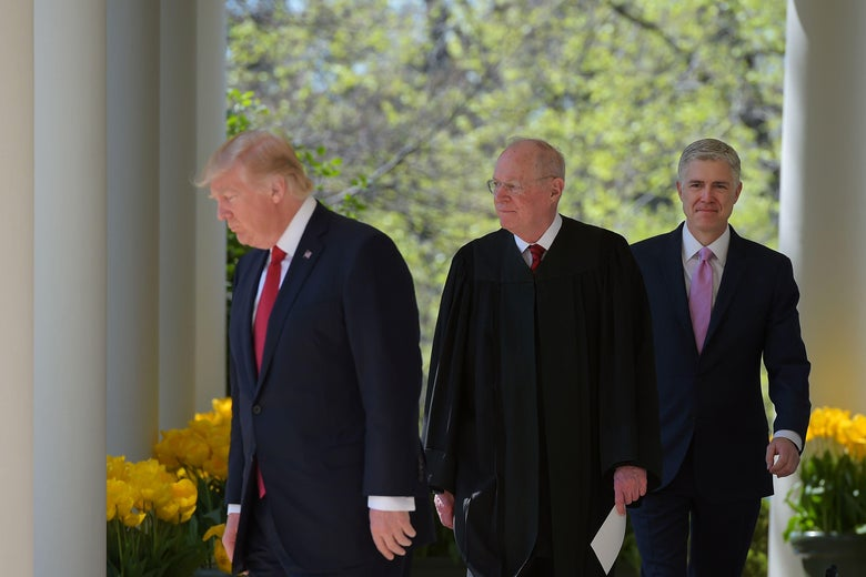 President Donald Trump, Justice Anthony Kennedy and Neil Gorsuch make their way to the Rose Garden of the White House for Gorsuch's swearing-in ceremony  on April 10, 2017.