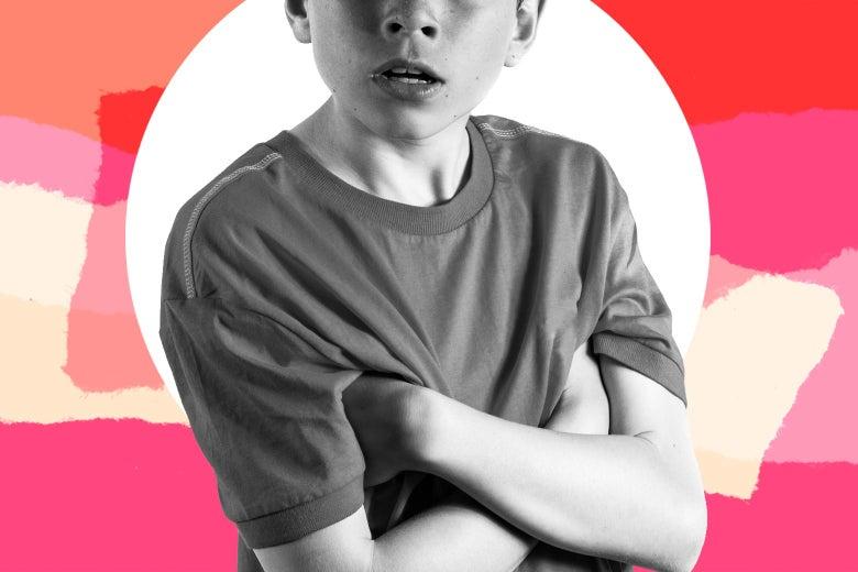 A teenage boy crossing his arms, looking defiant.