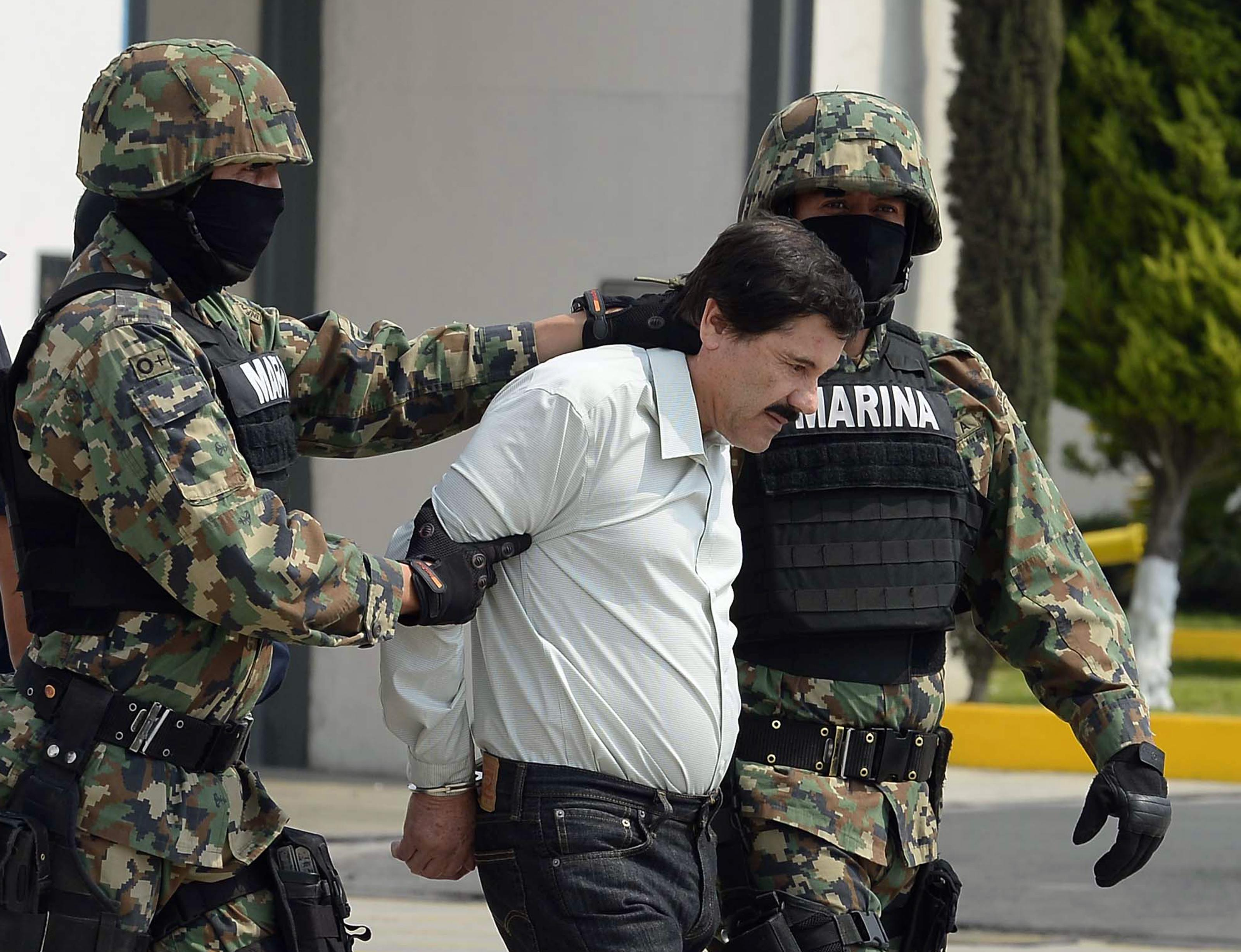 "Marines present Mexican drug lord Joaquín ""El Chapo"" Guzmán to the press in Mexico City after his arrest on Feb. 22, 2014."