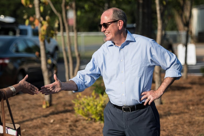Republican candidate Dan Bishop greets voters outside of a polling station on Tuesday in Charlotte, North Carolina.