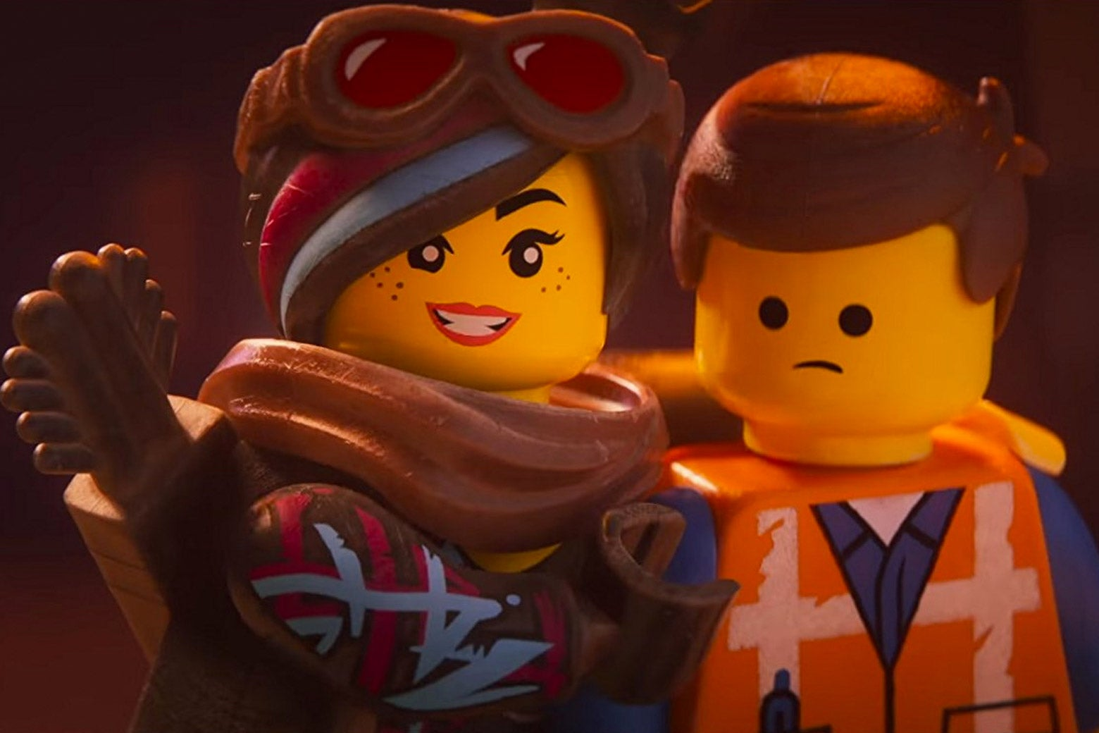 The Lego figurines Wyldstyle and Emmet.