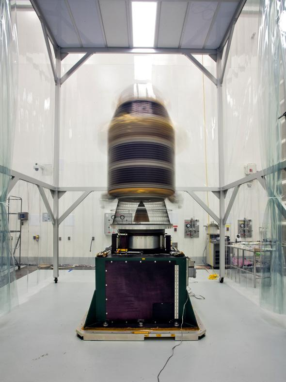 During preparations for NASA's Lunar Atmosphere and Dust Environment Explorer (LADEE) observatory launch on Sept. 6, 2013, engineers mounted it onto a spin table and rotate it at high speeds, approximately one revolution per second, to make sure that the spacecraft is perfectly balanced for flight.