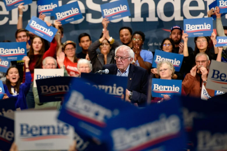Bernie Sanders stands at a podium amid a crowd of his supporters in Durham, North Carolina, on Friday.