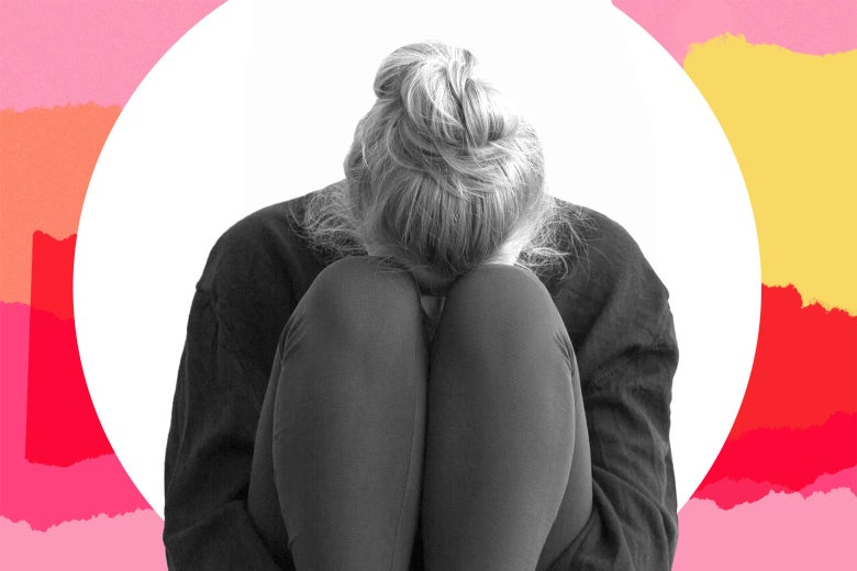 Sad teenager with face buried in her knees.