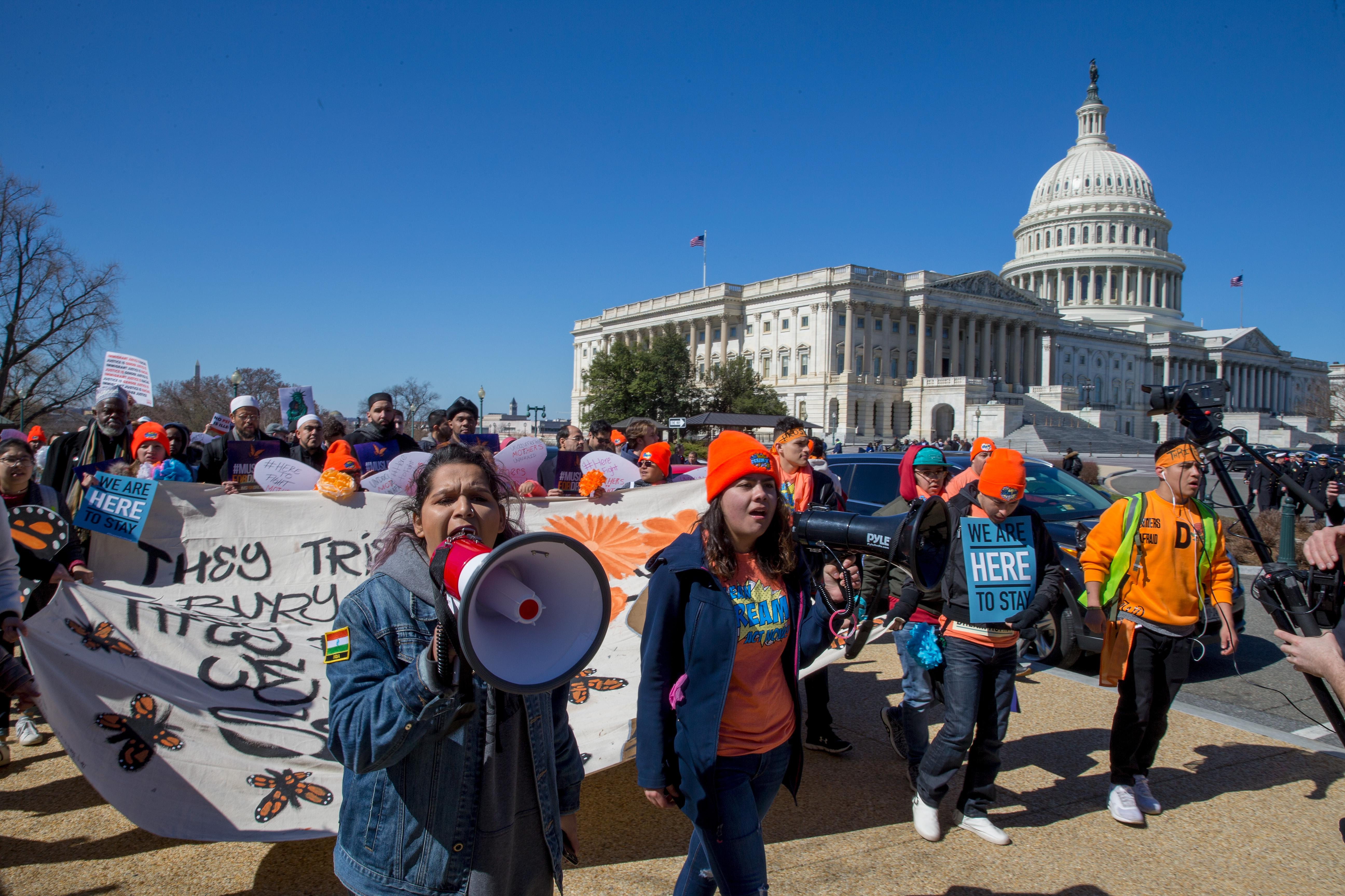 DACA supporters marching at the U.S. Capitol.