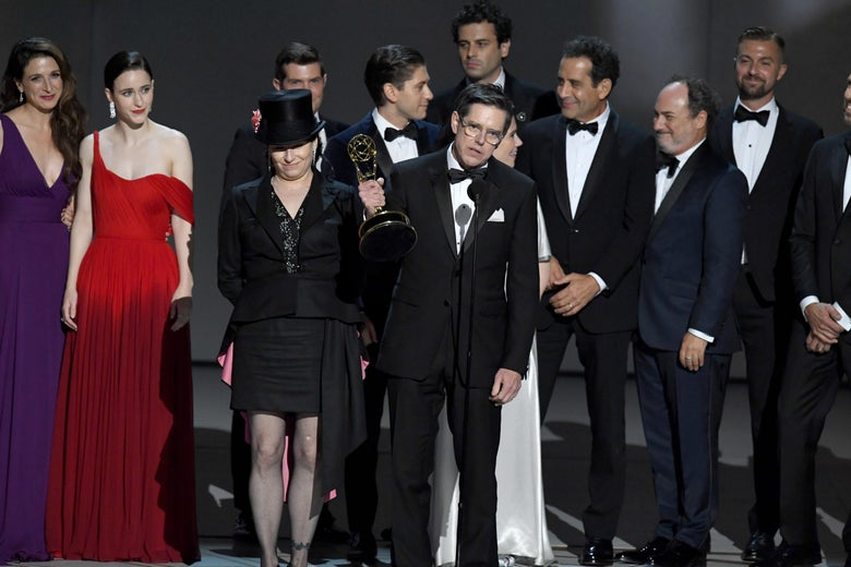 Amy Sherman-Palladino and Daniel Palladino and cast and crew accept the award onstage.