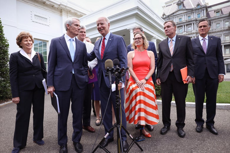 Biden stands smiling with the group in front of the White House