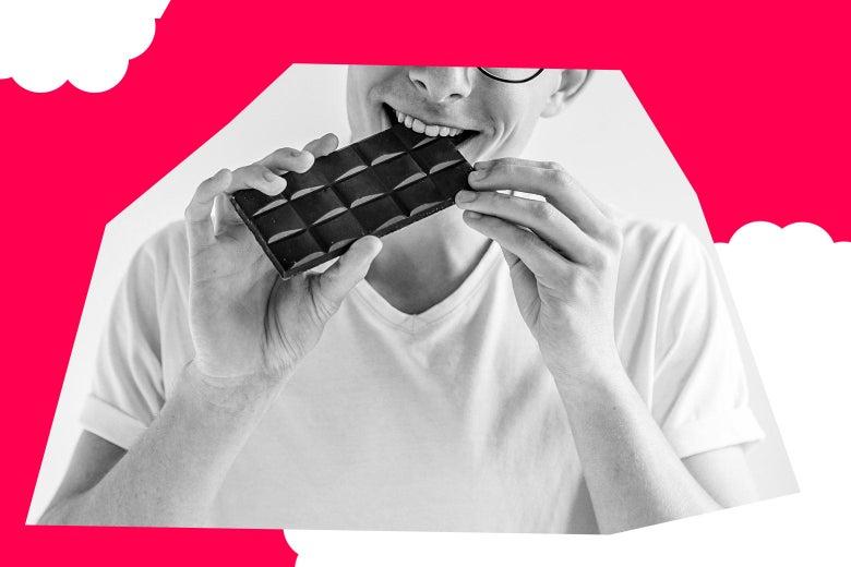 man eating a chocolate bar