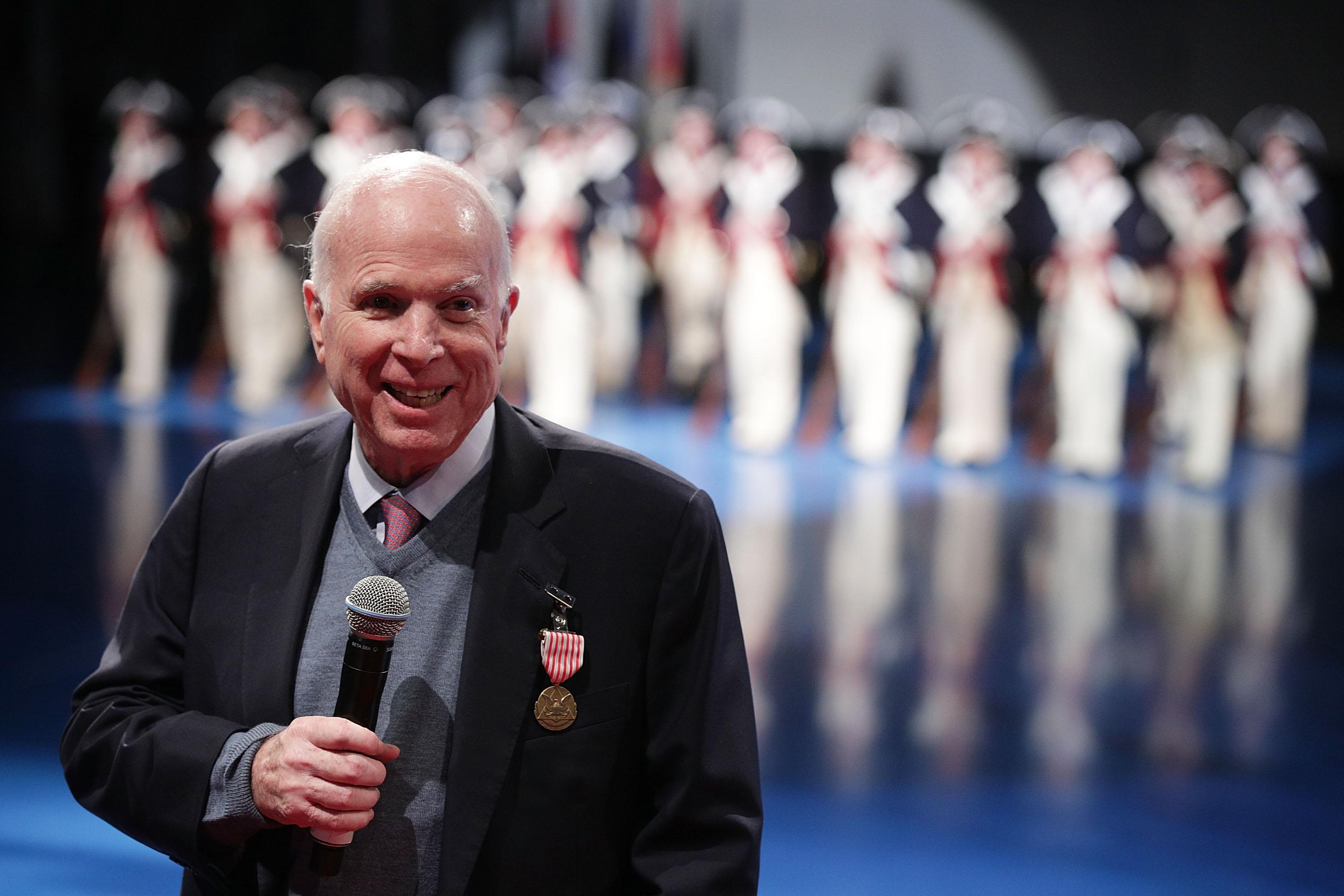 Sen. John McCain (R-AZ) speaks after he was presented with the Outstanding Civilian Service Medal during a special Twilight Tattoo performance November 14, 2017 at Fort Myer in Arlington, Virginia. Sen. McCain was honored for over 63 years of dedicated service to the nation and the U.S. Navy.