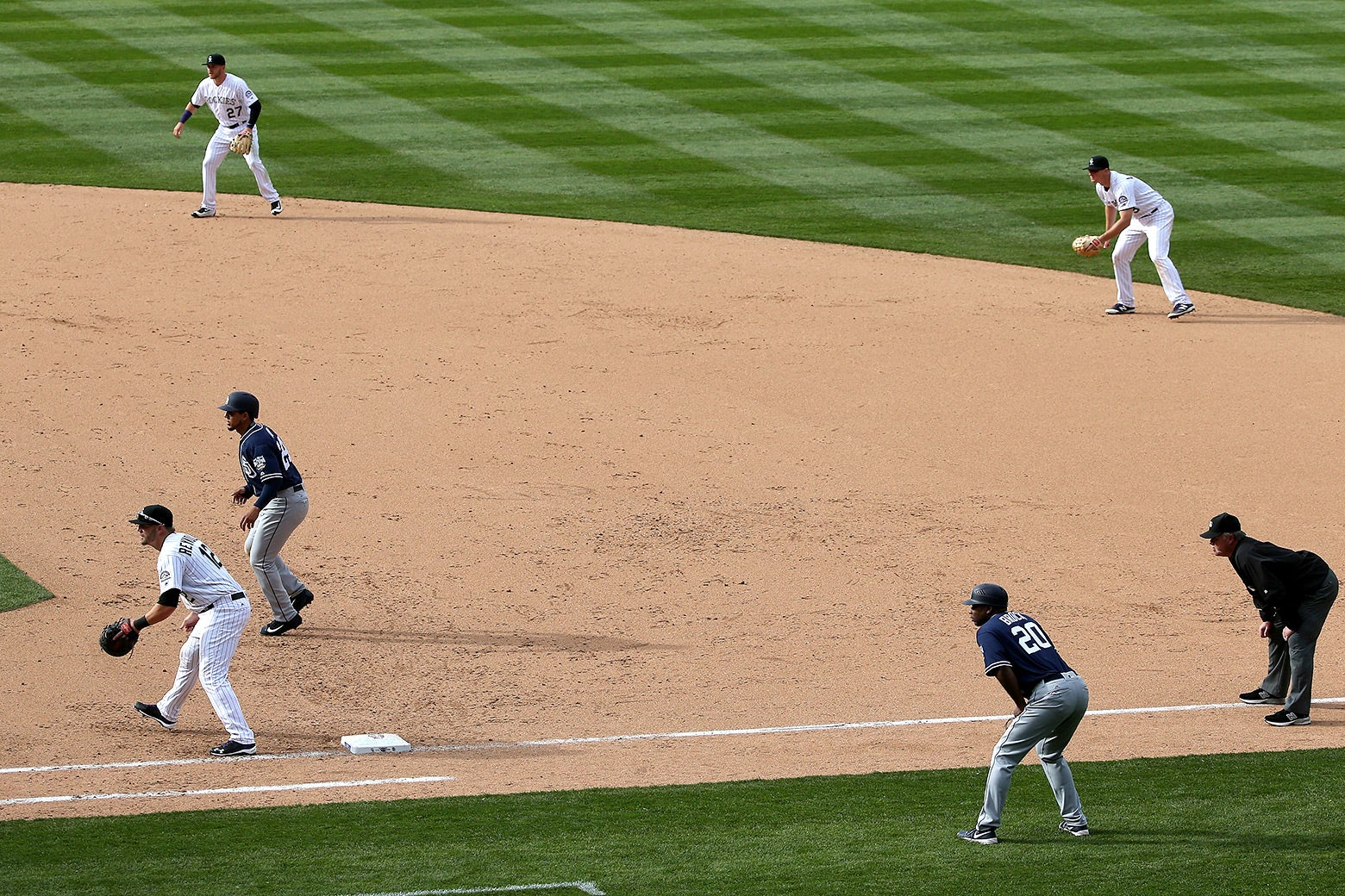 Colorado Rockies infielders Trevor Story, DJ LeMahieu, and Mark Reynolds play a defensive shift against the San Diego Padres on Apr. 8, 2016.