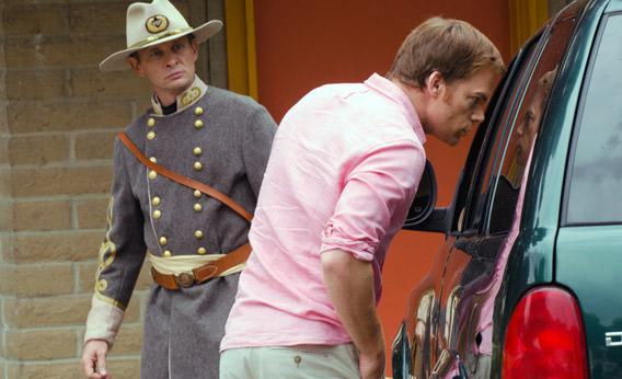 Brett Rickaby as Inspector Phil Bosso and Michael C. Hall as Dexter Morgan in Dexter.