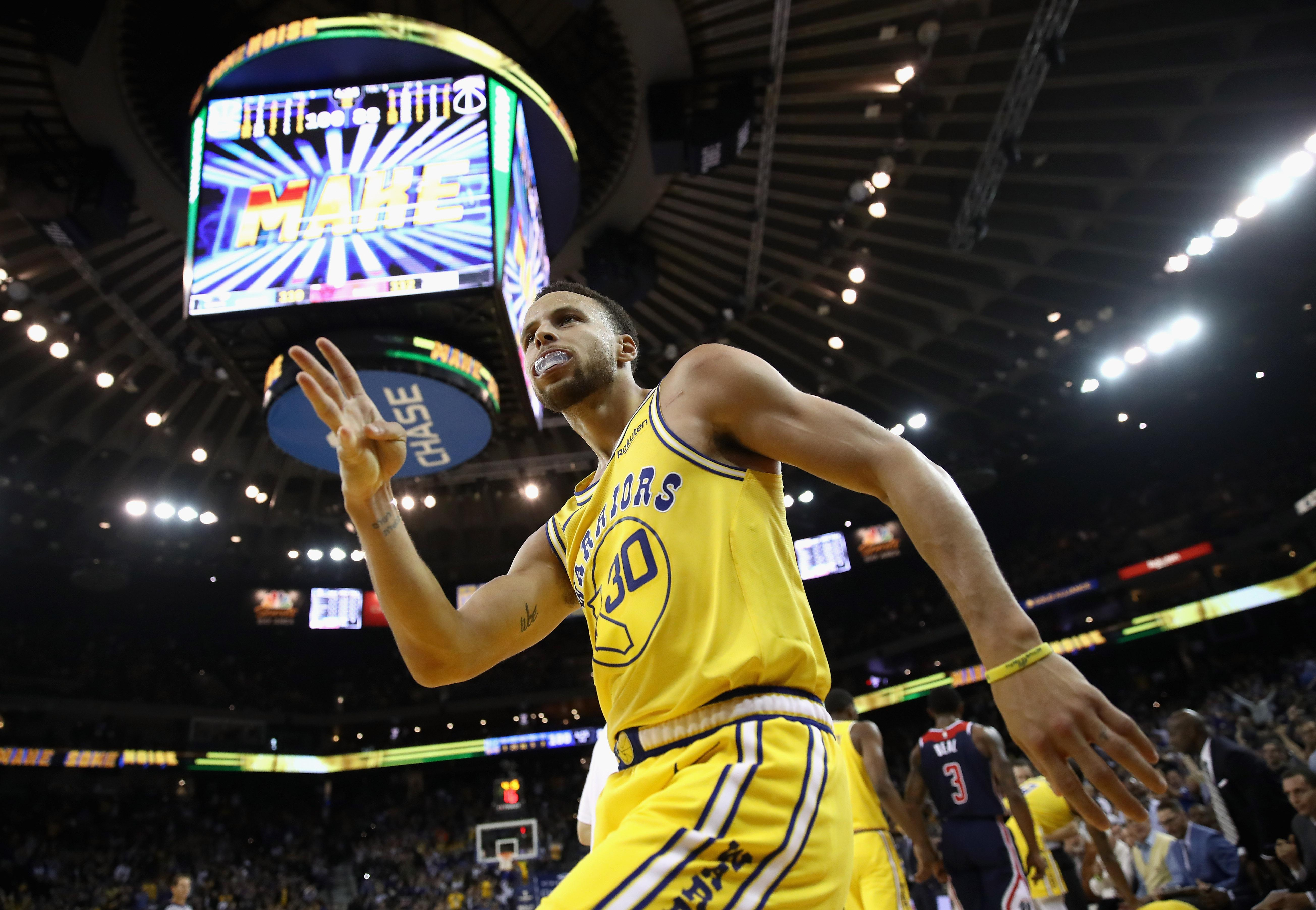 OAKLAND, CA - OCTOBER 24:  Stephen Curry #30 of the Golden State Warriors reacts after he made a three-point basket and was fouled by the Washington Wizards at ORACLE Arena on October 24, 2018 in Oakland, California.  NOTE TO USER: User expressly acknowledges and agrees that, by downloading and or using this photograph, User is consenting to the terms and conditions of the Getty Images License Agreement.  (Photo by Ezra Shaw/Getty Images)