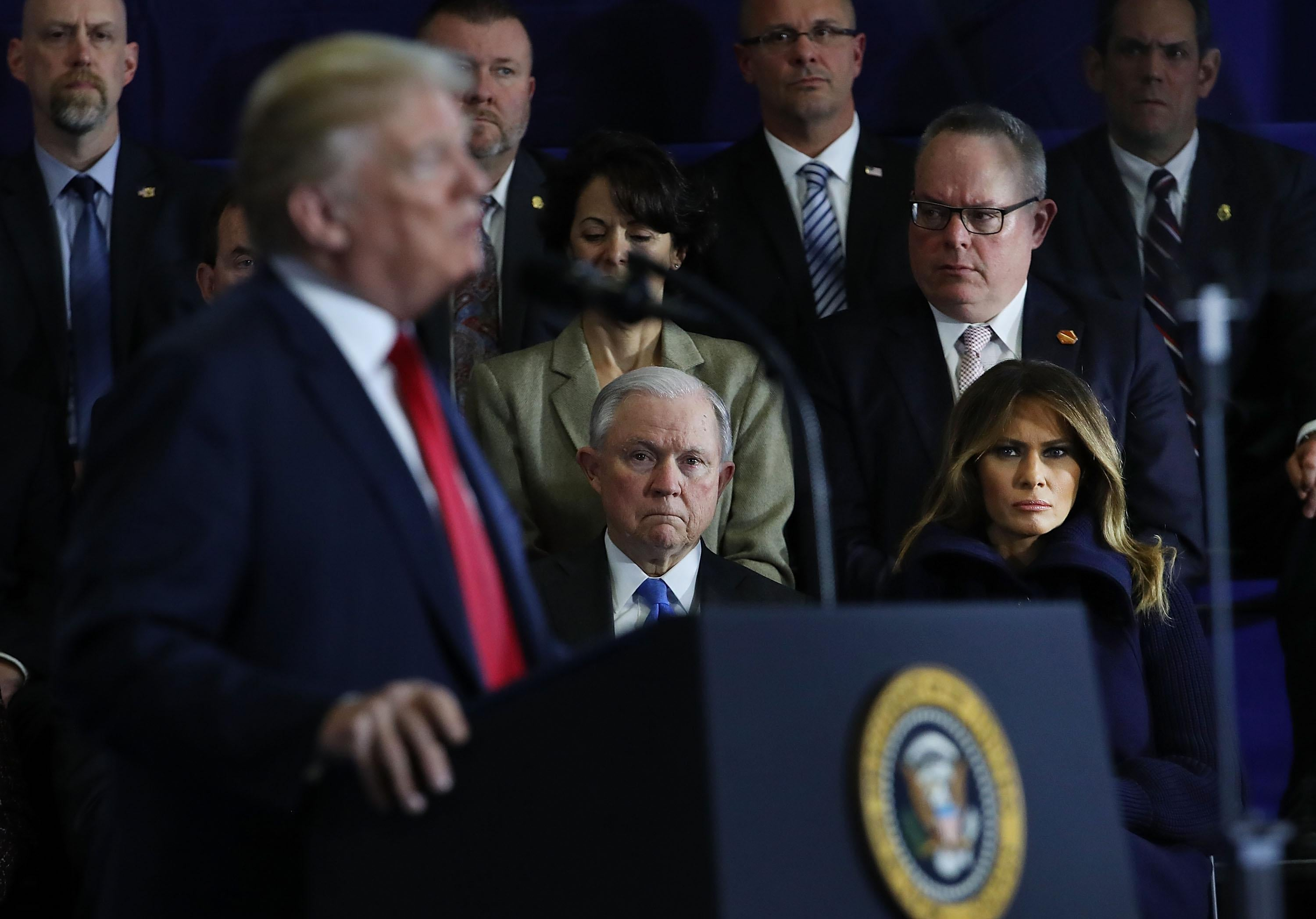 Attorney General Jeff Sessions watches as President Donald Trump speaks to supporters, local politicians and police officers at an event at Manchester Community College on March 19, 2018 in Manchester, New Hampshire.