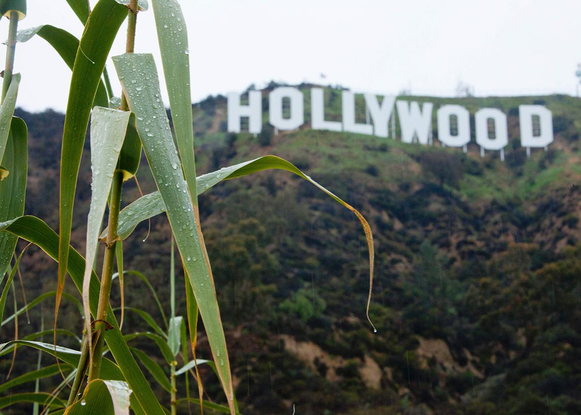The Hollywood sign is seen during a rain storm in Hollywood, California on January 12, 2017.