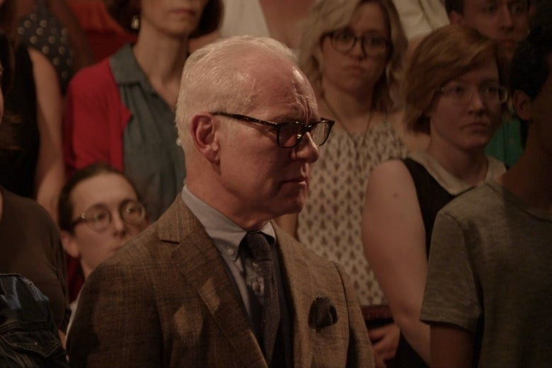 Tim Gunn, standing in a theatrical audience.