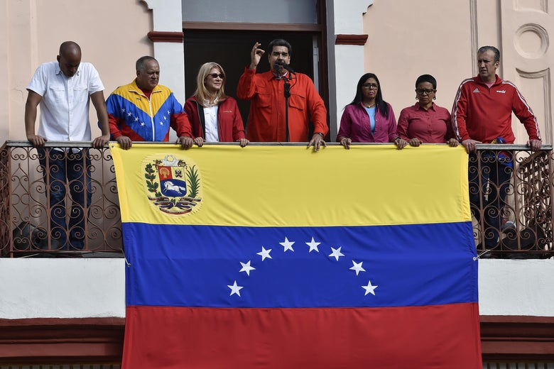 Venezuela's President Nicolas Maduro speaks from a balcony at Miraflores Presidential Palace to a crowd of supporters during a gathering in Caracas on January 23, 2019.