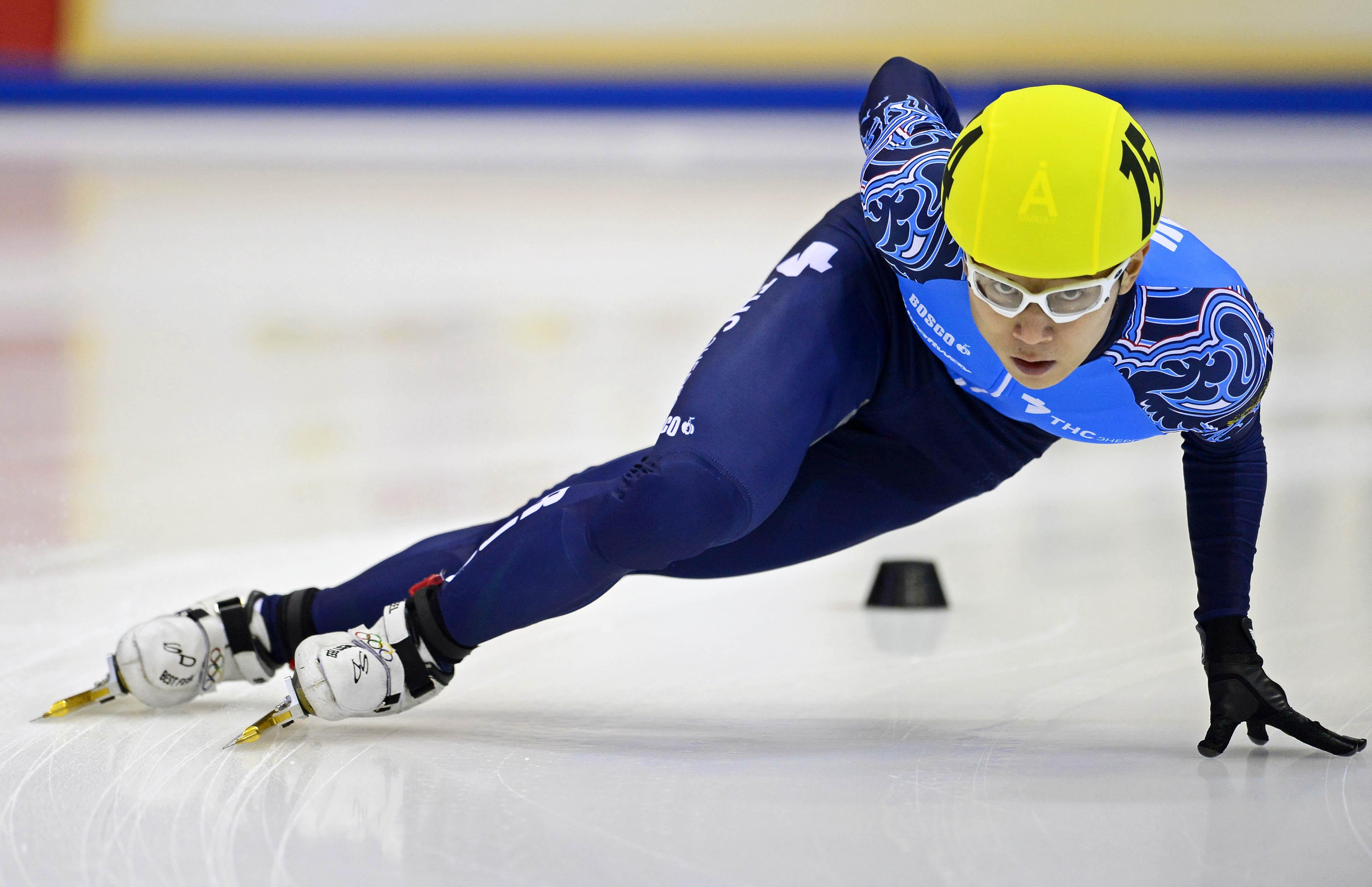 Victor An of Russia competes in the men's 1000m heat race of the ISU European Short Track speed skating Championships in Dresden, eastern Germany, on January 19, 2014.