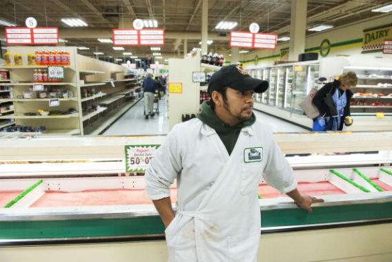 Denis Trana, a meat cutter for 14 years at Magruder's, is unsure of his future.