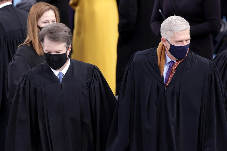 The three justices stand in their robes at Joe Biden's inauguration