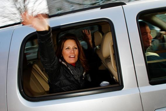 U.S. Republican presidential candidate and Representative Michele Bachmann (R-MN) waves as she leaves Uncle Nancy's Coffeeshop during a campaign stop in Newton, Iowa December 23, 2011.