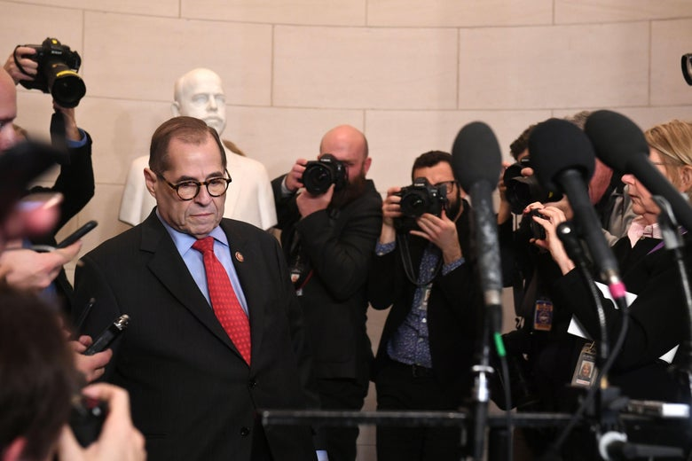 Jerry Nadler, surrounded by reporters and photographers.