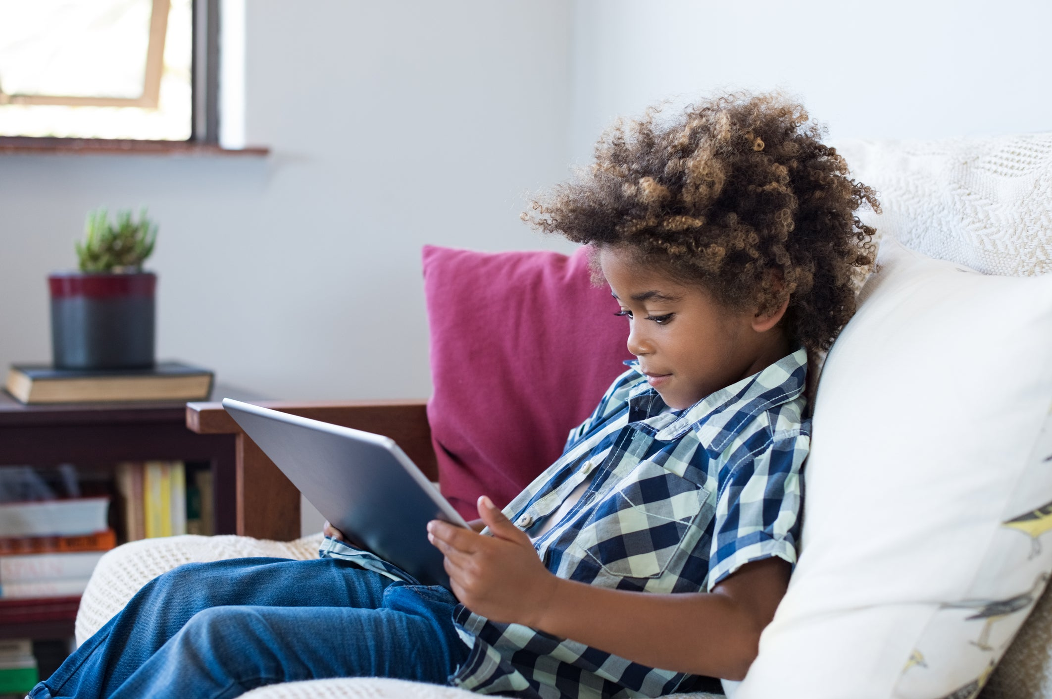 A child watching something on a tablet
