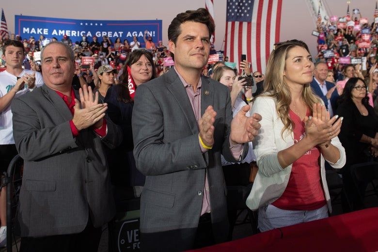US Representative Matt Gaetz (C), Republican of Florida, applauds as US President Donald Trump holds a Make America Great Again rally as he campaigns at Orlando Sanford International Airport in Sanford, Florida, October 12, 2020. (Photo by SAUL LOEB / AFP) (Photo by SAUL LOEB/AFP via Getty Images)