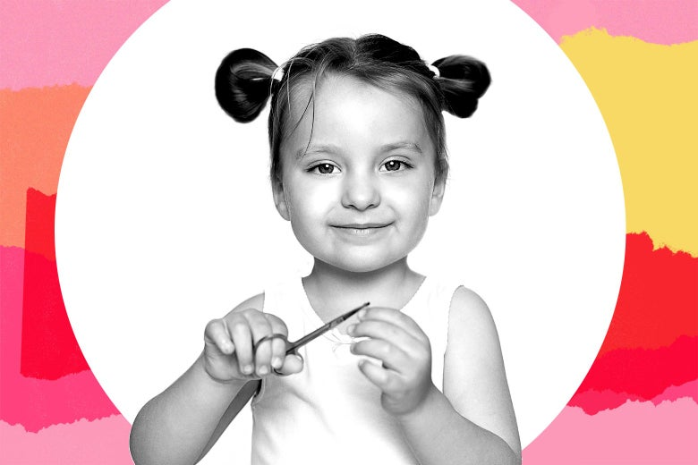 A toddler with her hair in twin buns smiles serenely while holding a pair of scissors.