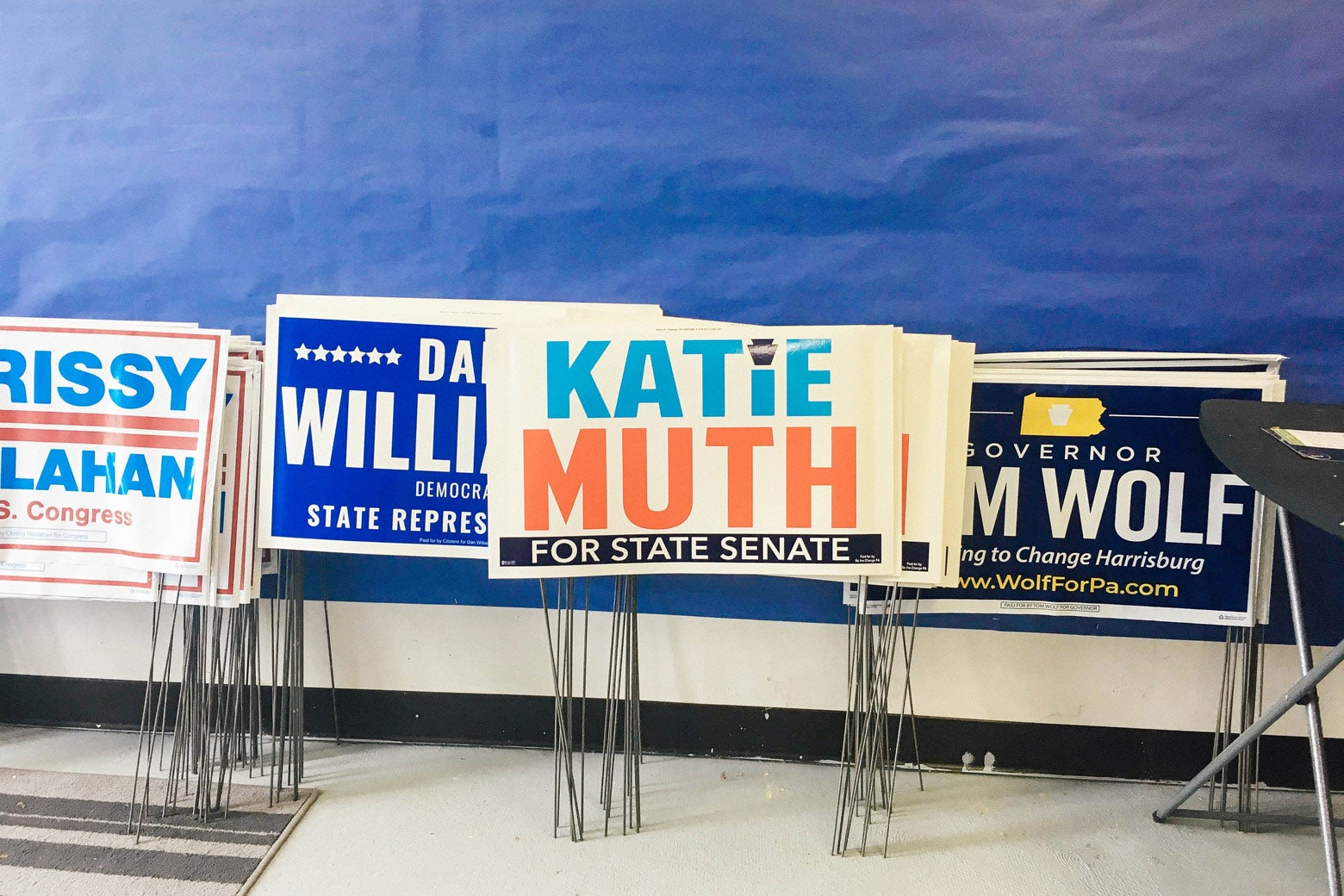 Katie Muth's yard signs sit alongside those of fellow Democrats at her campaign office in Exton, Pennsylvania.