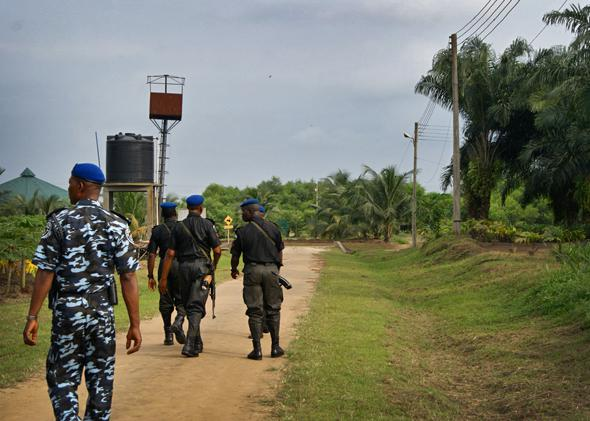 Heavily armed police and military officers patrol a farm road outside of Port Harcourt. Militant activity remains a problem throughout the region.