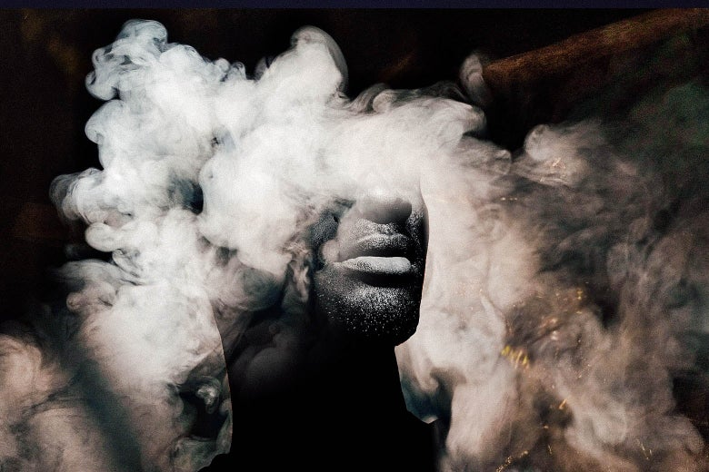 A black-and-white photo of a Black man surrounded in a cloud of smoke.