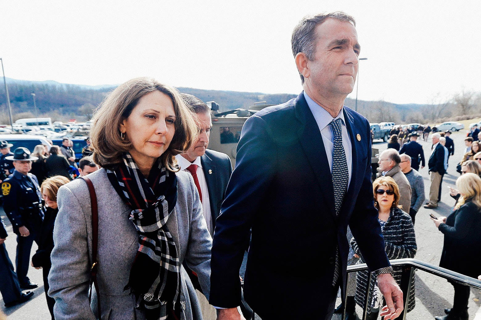Virginia first lady Pam Northam and Gov. Ralph Northam hold hands as they leave the funeral for Virginia State Trooper Lucas B. Dowell on Feb. 9 in Chilhowie, Virginia.