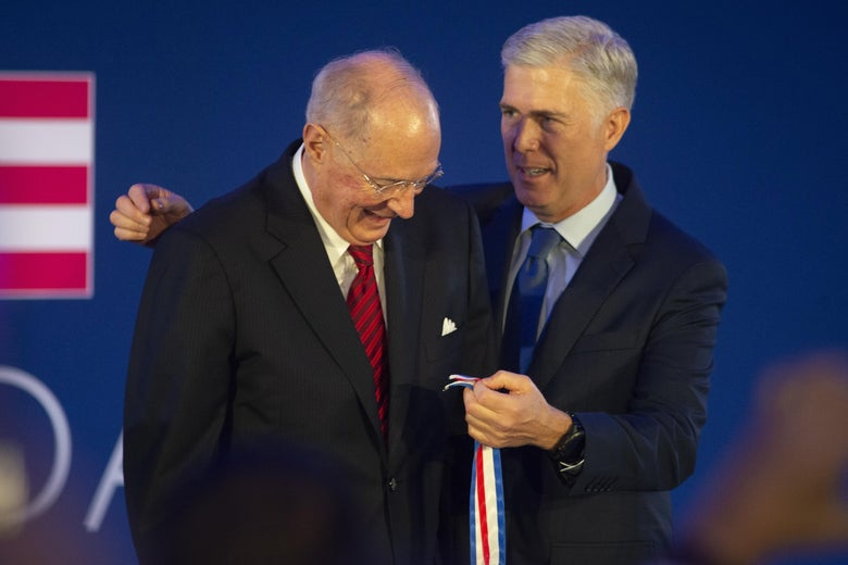 Justice Neil Gorsuch puts the Liberty Medal around retired Justice Anthony Kennedy at a 2019 ceremony.