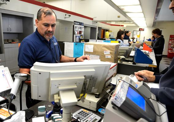 U.S. Postal Service clerk helps a customer.