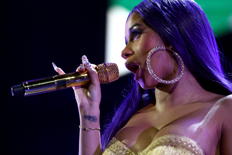 Cardi B performing onstage.