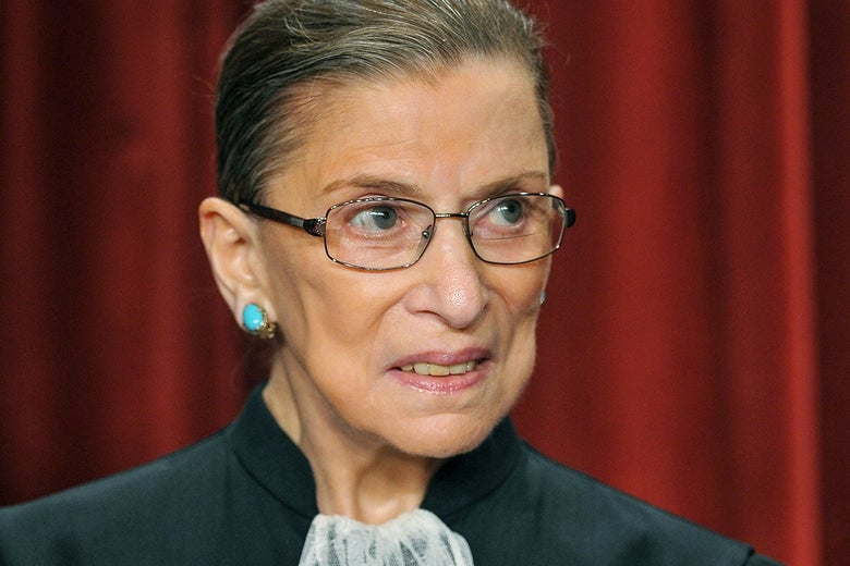 Ruth Bader Ginsburg in front of a red curtain at the Supreme Court.