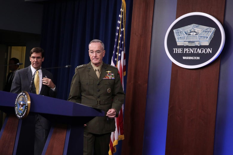Secretary of Defense Mark Esper and Chairman of Joint Chiefs of Staff General Joseph Dunford arrives at a media briefing at the Pentagon August 28, 2019 in Arlington, Virginia.