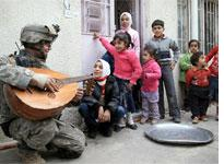 A U.S. soldier plays the oud for some Iraqi children         Click image to expand.