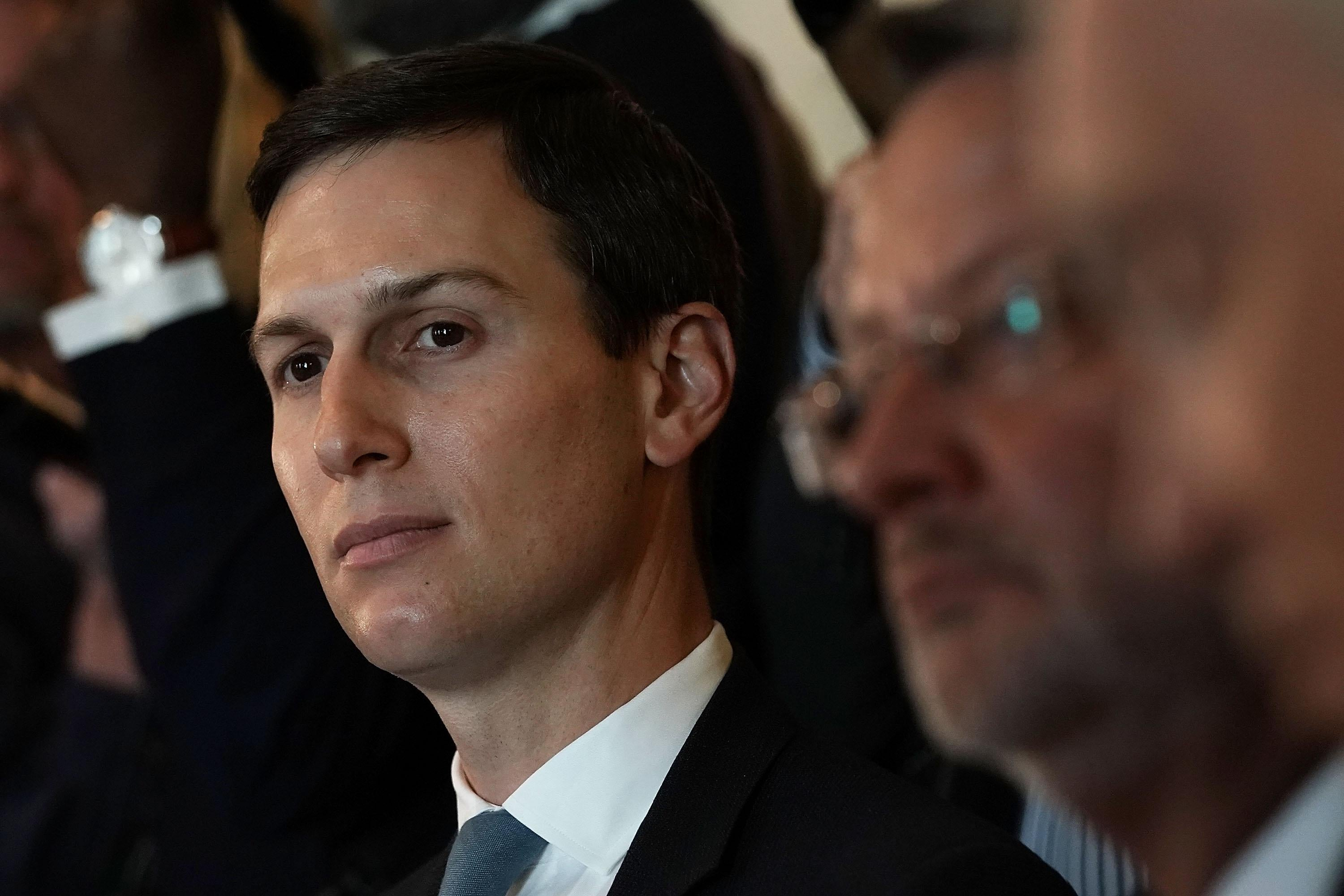 Jared Kushner listens during a meeting between President Donald Trump and congressional members in the Cabinet Room of the White House February 13, 2018 in Washington, D.C.
